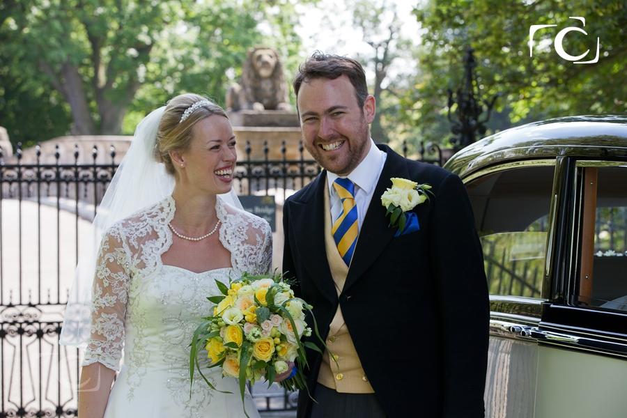 Rolls Royce wedding car at Lions bridge Burghley House