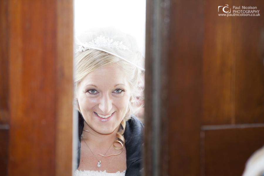 Bride at The doorway Normanton Church Rutland Oakham