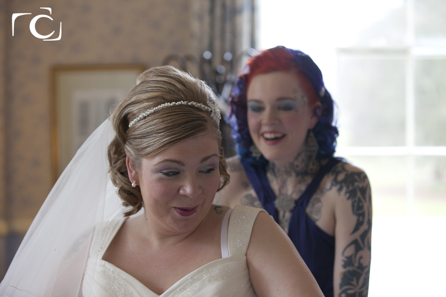 Wedding photography of Bride and Bridesmaid getting ready at The Orton Hall Hotel