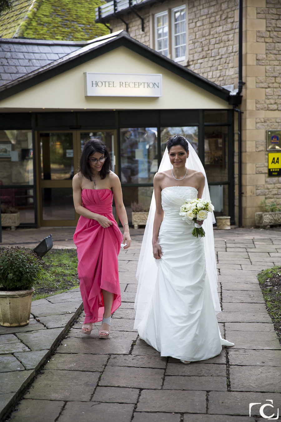 Bride and Bridesmaid outside the Orton Hall Hotel Peterborough