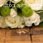 Alan and Sandra's wedding rings and flowers at The Toft Hotel and Golf Club